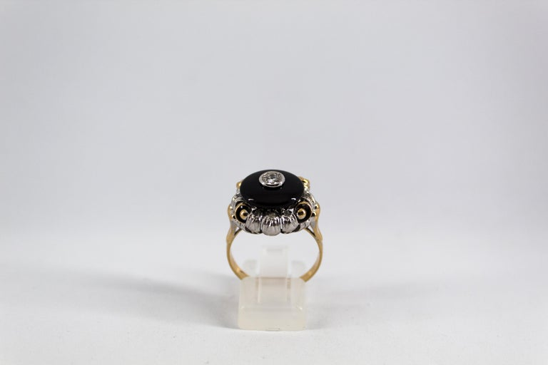 This Ring is made of 18K Yellow and White Gold. This Ring has a 0.20 Carats White Diamond. This Ring has also Onyx. This Ring is inspired by Renaissance Style. Size ITA: 21 USA: 9.5 We're a workshop so every piece is handmade, customizable and