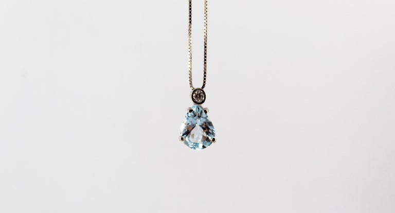 This Necklace is made of 18K White Gold. This Necklace has a 0.03 Carats White Diamonds. This Necklace has a 1.20 Carats Aquamarine. This Necklace is inspired by Art Deco. The Necklace Length is 45cm. We're a workshop so every piece is handmade,