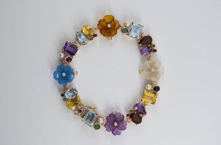This Bracelet is made of 14K Yellow Gold. This Bracelet has 0.20 Carats of White Diamonds. This Bracelet has 0.90 Carats of Sapphires, Rubies and Emeralds. This Bracelet has also Topaz, Amethyst, Citrine, Rock Crystal, Garnet, Agate, Pearl,