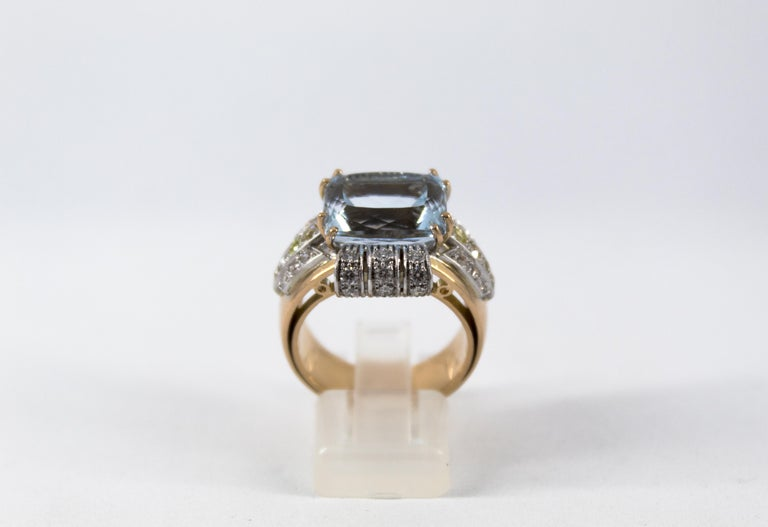 This Ring is made of 14K Yellow Gold. This Ring has 0.94 Carats of White and Yellow Diamonds (Old Cut Diamond). This Ring has a 7.18 Carats Aquamarine. Size ITA: 17 USA: 8 We're a workshop so every piece is handmade, customizable and resizable.