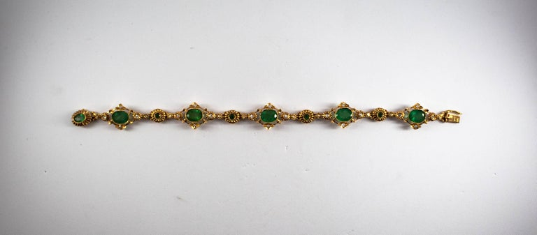 This bracelet is made of 14K Yellow Gold. This bracelet has 0.50 Carats of White Diamonds. This bracelet has 5.70 Carats of Zambia Natural Emeralds. We're a workshop so every piece is handmade, customizable and resizable.