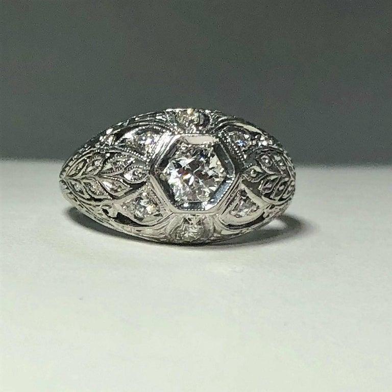 Women's Art Deco Platinum and 18 Karat Gold European Cut Diamond Dome Engagement Ring For Sale