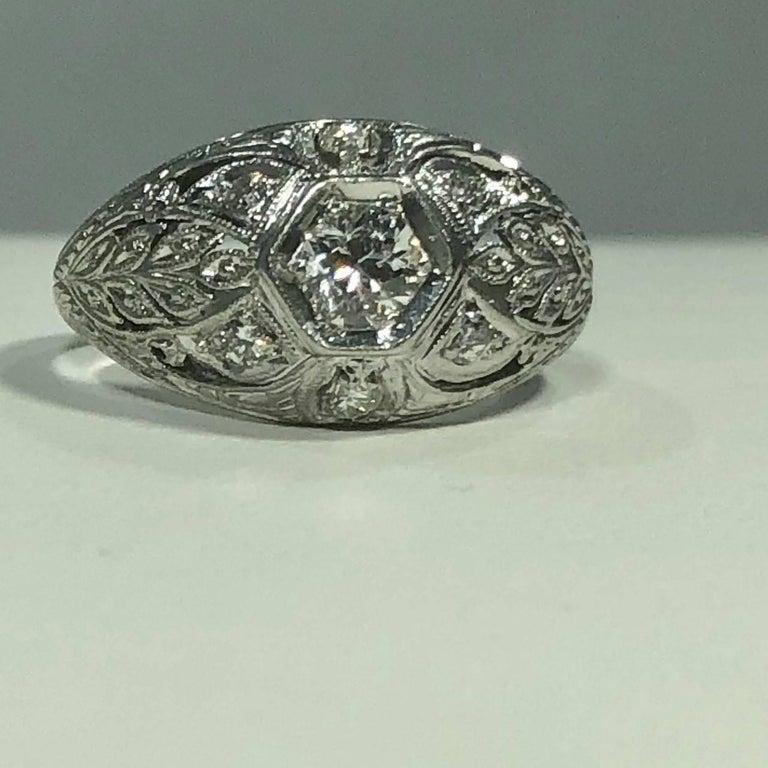 Art Deco Platinum and 18 Karat Gold European Cut Diamond Dome Engagement Ring For Sale 1