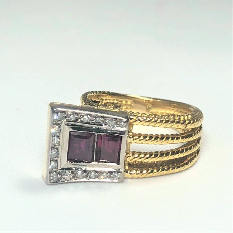 Vintage J Rossi 18 Karat 2 tone European Cut Ruby and Diamond fashion ring. This unique creation is a true vintage piece circa 1970, J Rossi one of a kind creation. This piece is created in 18 karat 2 tone yellow and white gold, weighing 7.0 grams,
