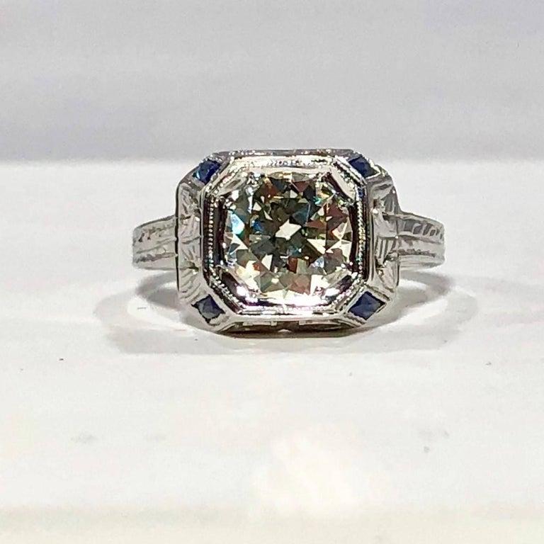 Old European Cut Art Deco 18 Karat 1.40 Carat European Cut Diamond and Sapphire Engagement Ring For Sale