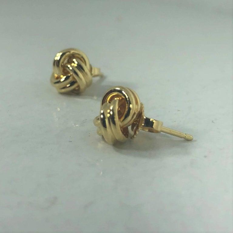 Women's or Men's Tiffany & Co. 18 Karat Yellow Gold Love Knot Stud Earrings For Sale