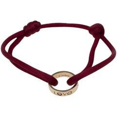 Cartier 18 Karat Rose Gold Charity Love Pendant Silk Chord Bracelet