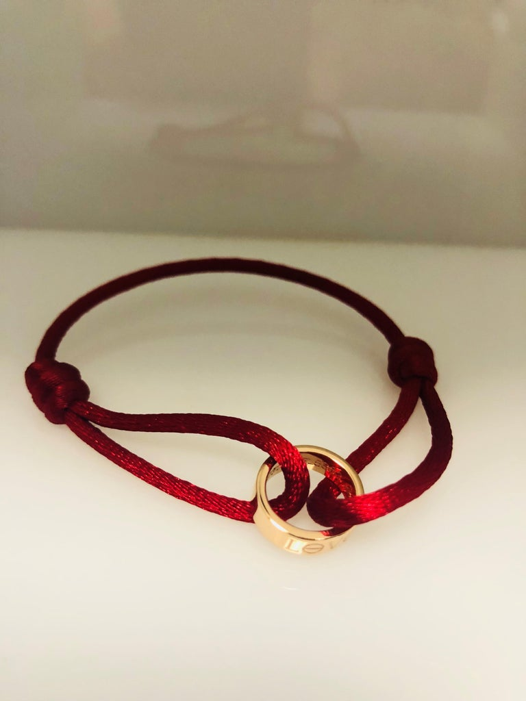 Modern Cartier 18 Karat Rose Gold Charity Love Pendant Silk Chord Bracelet For Sale