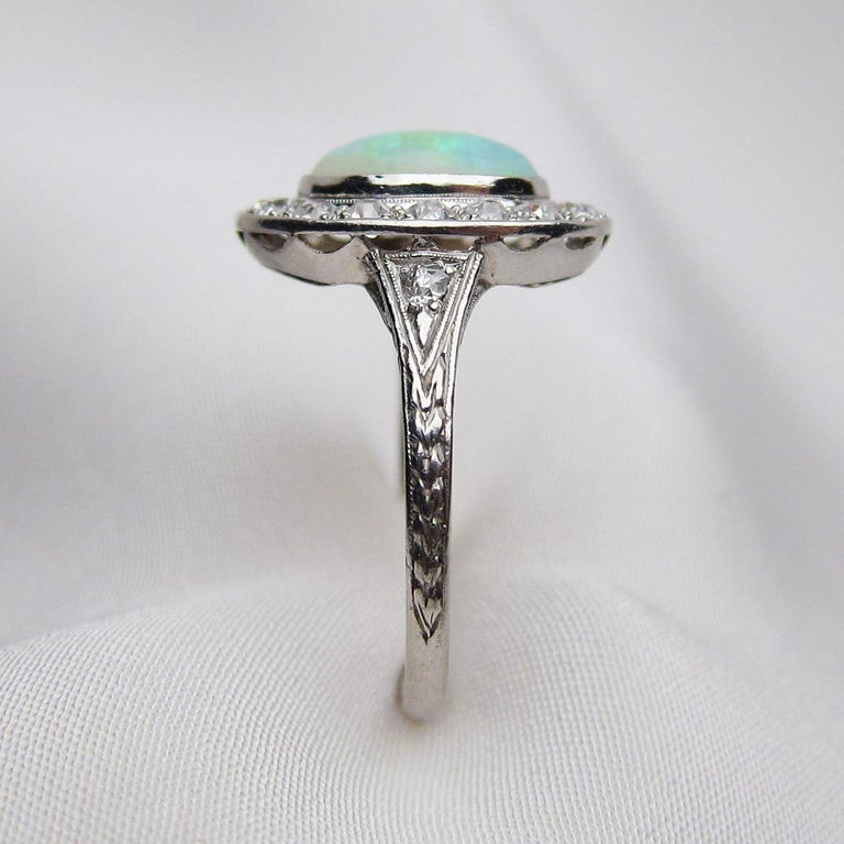 Art Deco 1.40 Carat Cabochon-Cut Opal and Diamond Halo Platinum Ring In Excellent Condition For Sale In Seattle, WA
