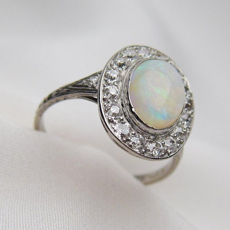 Old European Cut Art Deco 1.40 Carat Cabochon-Cut Opal and Diamond Halo Platinum Ring For Sale
