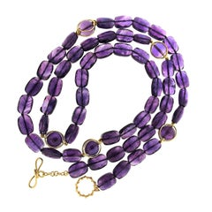 Faceted Amethyst with Five Doppio Balls in 18 Karat Yellow Gold