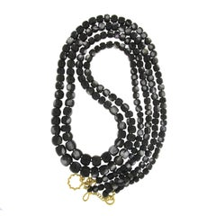 Multi-Strands of Barrel Shaped Faceted Black Mother-of-Pearl Necklace