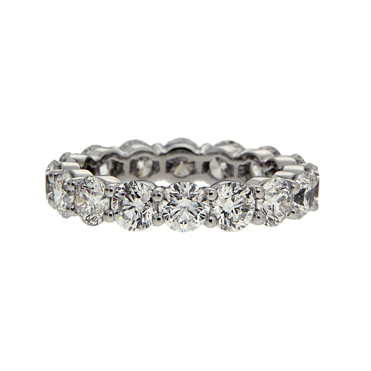 This eternity wedding band features prong set round brilliant diamonds.