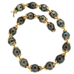 Tahitian pearl necklace with gold leaf motif connectors