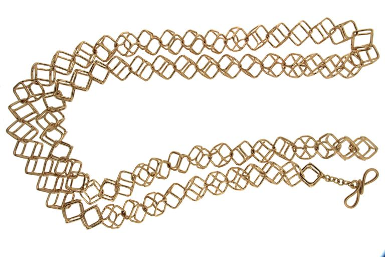 This modern necklace features 73 Interlocking cushion cubes in 18kt yellow gold. The length is 38 inches long