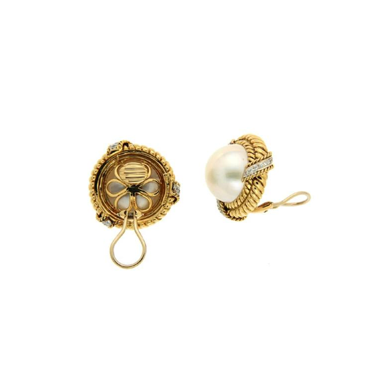 These earrings are made in 18kt yellow gold, with mabe pearls and double twisted ropes with three diamond set bars. Diamond carat total weight is 0.67, the earrings are finished with clip-backs.