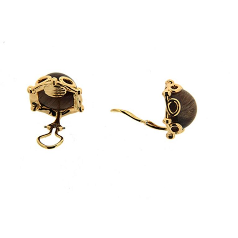 The earrings are made in 18kt yellow gold they feature round rutilated quartz and are finished with clip-backs.