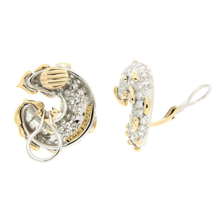 These earrings are made in 18kt yellow gold, they feature 132 round brilliant diamonds, and have a diamond carat total weight of 5.09cts.  Backs are clip-backs
