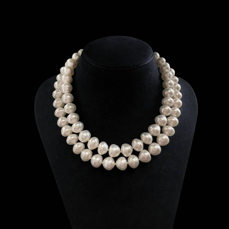 This 35 inch cone south sea pearl necklace has 71 pearls of measurement 13.9mm - 13mm. This necklace is finished with 18kt yellow gold Knot ring and toggle.