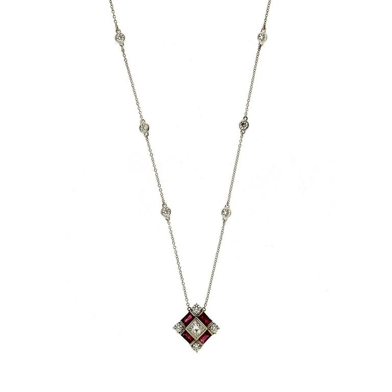 "Princess Cut Center Diamond with Baguette Rubies and Round Diamonds Side stones with 6 bezel set Diamonds on 16"" Chain in 18kt White Gold.