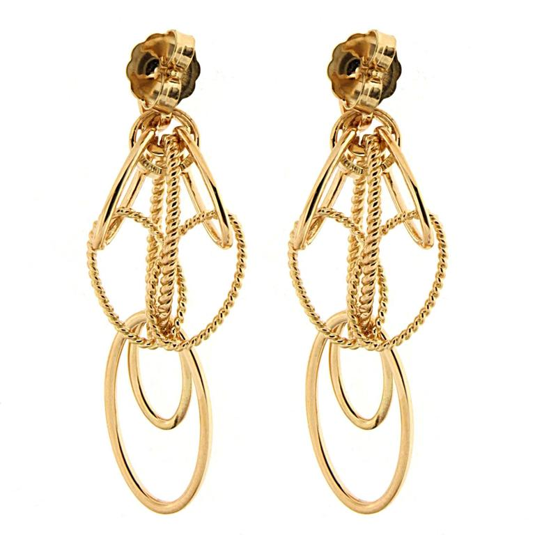 This elegant pair of Cascading Oval Twisted and Plain Wire Earrings is designed with plain ovals and twisted oval links. The earrings are finished in 18kt yellow gold with posts. This is a smaller version.  Large version also available.