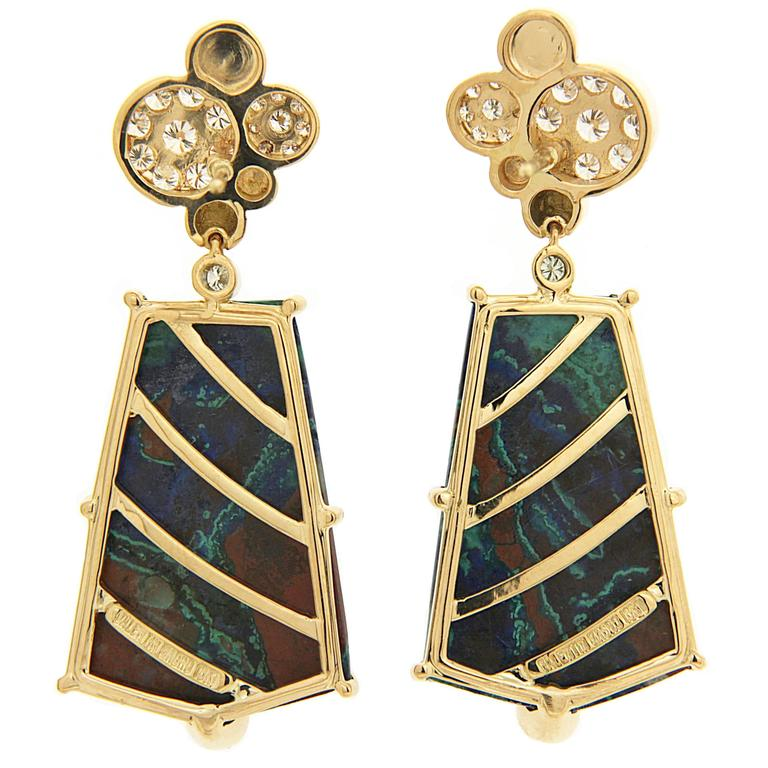 This pair of earrings features special cut Azurite Malachite with diamond pave circle motif tops. The earrings are finished in 18kt yellow gold with posts.