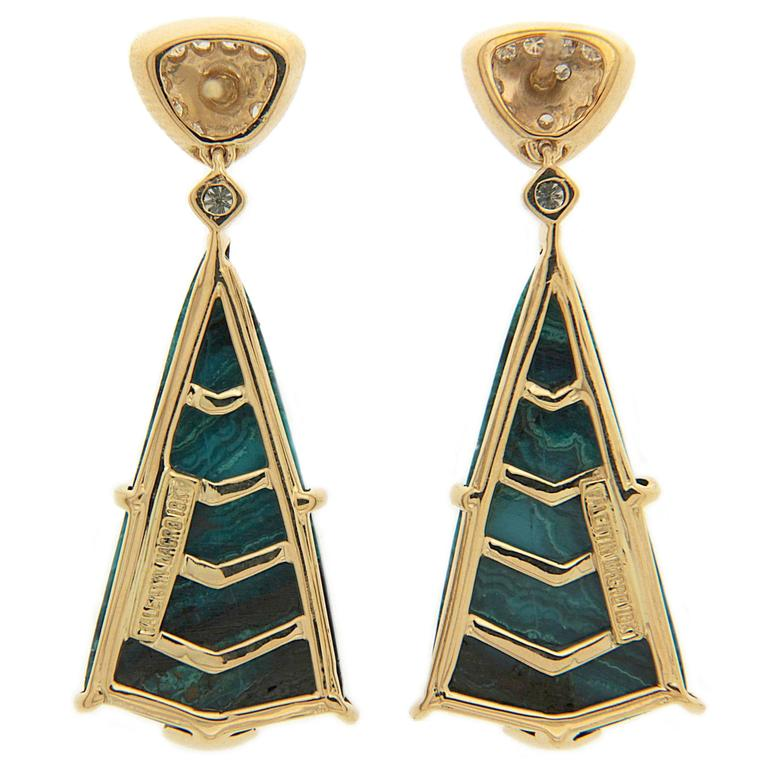 This unique pair of earrings feature special cut Chrysocolla Malachite drops with Triangle Top motifs and diamond accents. The earrings are finished in 18kt yellow gold with posts.