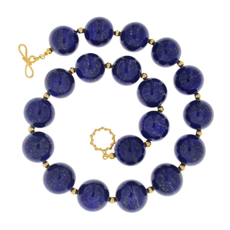 This necklace features twenty 20mm Lapis Lazuli balls with gold balls. The necklace is completed with 18kt yellow gold medium twisted wire knot with wire link toggle.