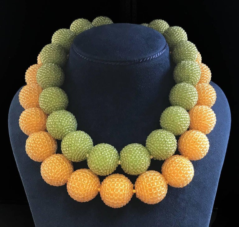 For decades, Valentin Magro's fine jewelry creations have illuminated the most special of occasions. This unique necklace features nineteen 24-25mm Peridot Woven Balls with 18kt yellow gold Medium plain knot with wire link toggle.