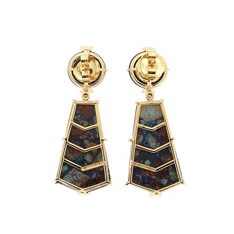 This pair of unique earrings features round Lapis Lazulli top with special cut Azurite Malachite decorated with triangle diamond pave motifs. The earrings are completed in 18kt Yellow Gold.