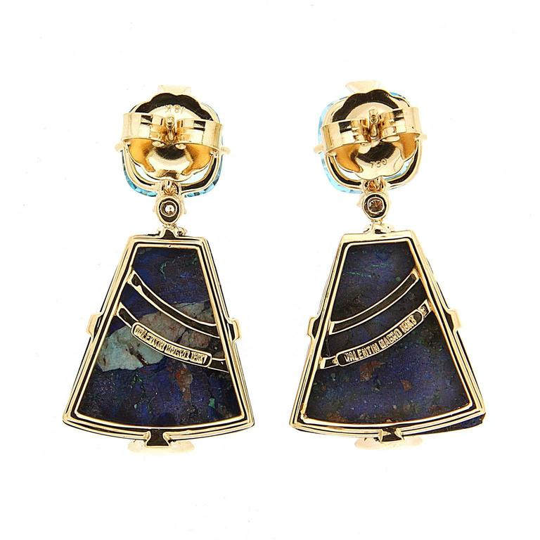 These lovely earrings features blue cushion Topaz and trapezoid Azurite Malachite with triangular pave motif in 18kt Yellow gold. Clip backs (post can be added on upon request).