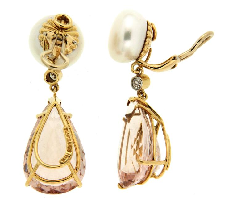 This lovely pair of earrings feature two round white Button Pearl with a round brilliant diamond bezel set connector and a pair of pear shape Morganite Faceted Drop. The earrings are completed in 18kt yellow gold with clip backs.