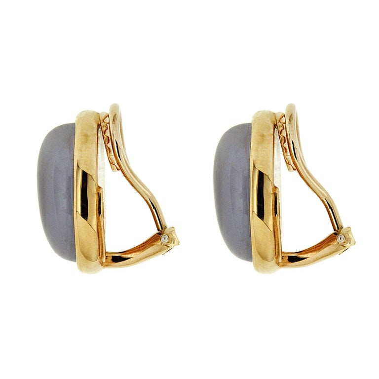 A modern interpretation of a classic, this lovely pair of earrings features special cut bean shape Chalcedony set on a gold plate with a thin frame in 18kt yellow gold, completed with clip back (posts can be added on upon request).