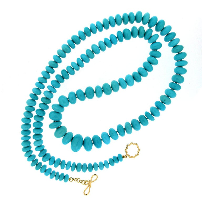 This necklace created by Valentin Magro shows off turquoise's beauty. 132 Rondelles of graduated size, including 17 x 8.2mm, spans the necklace. Each bead is selected for its uniform blues and how it harmonizes with its neighbors. An 18k yellow gold