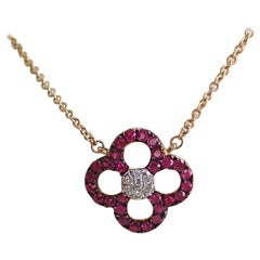 Ruby and Diamond Flower Pendant Hangs from Cable Chain - 14 Karat Yellow Gold