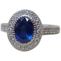 1.59 Carat Oval Sapphire Ring with 0.45 Carat of Diamond in 18 Karat White Gold