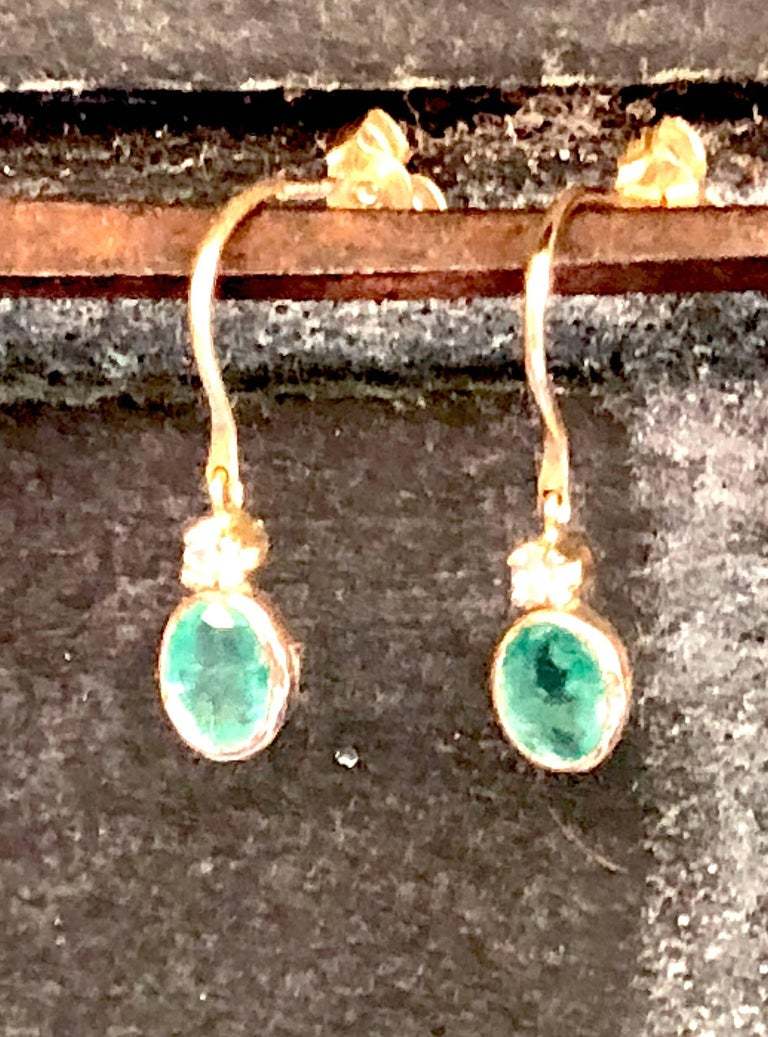 Emerald and diamond small dangling earring , 14K gold loop