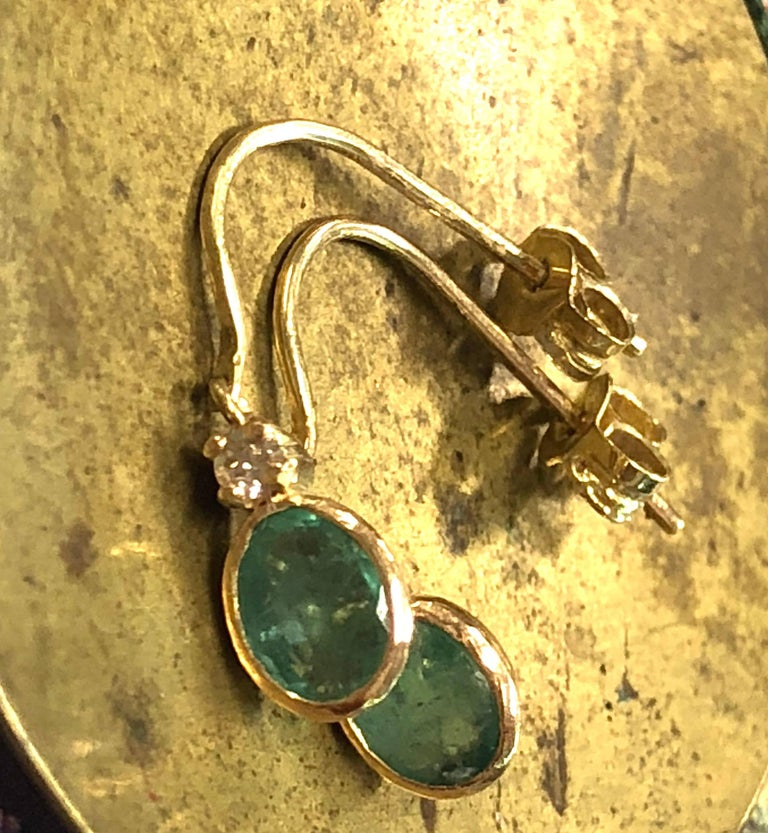 Oval Cut 14 Karat Gold Green Emerald and Diamond Small Dangling Earrings For Sale