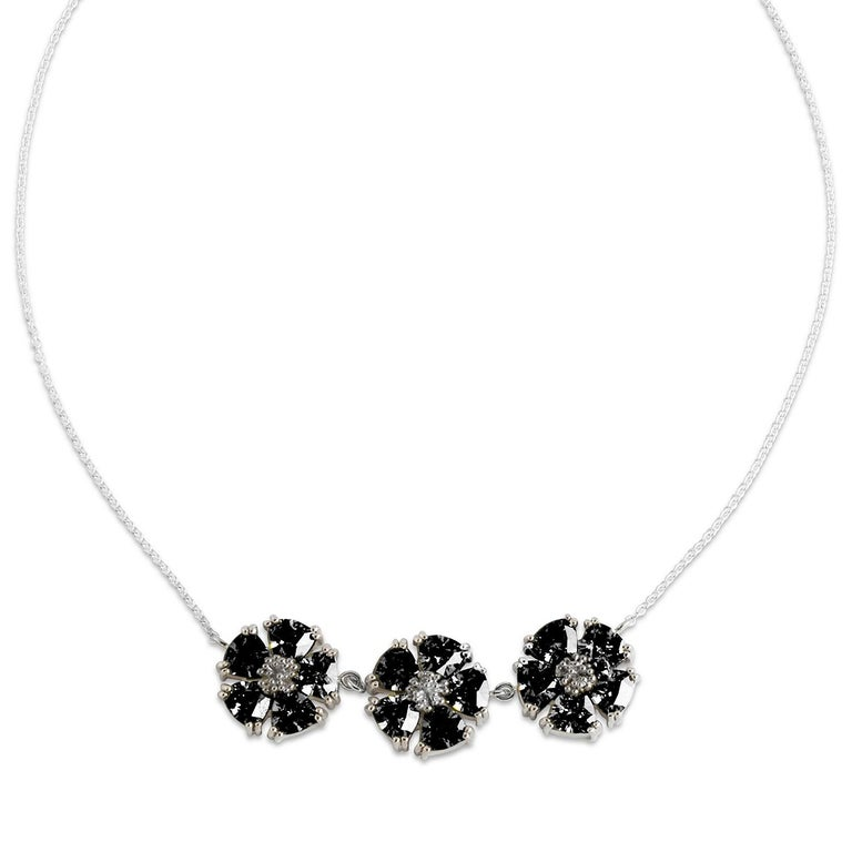 Designed in NYC  .925 Sterling Silver 15 x 7 mm White Sapphire 123 Blossom Stone Necklace. The beauty of blossom gets even more beautiful with stones and delivered front and center at the neck's nape. 123 blossom stone necklace:   Sterling silver