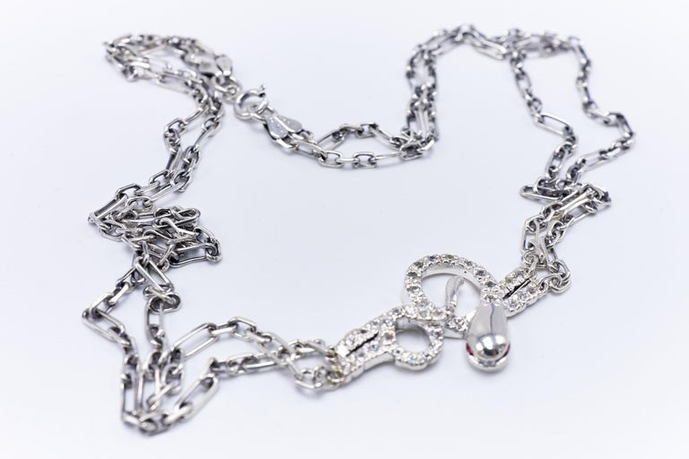 Contemporary Sapphire Snake Choker Necklace with Ruby Eyes in Silver For Sale