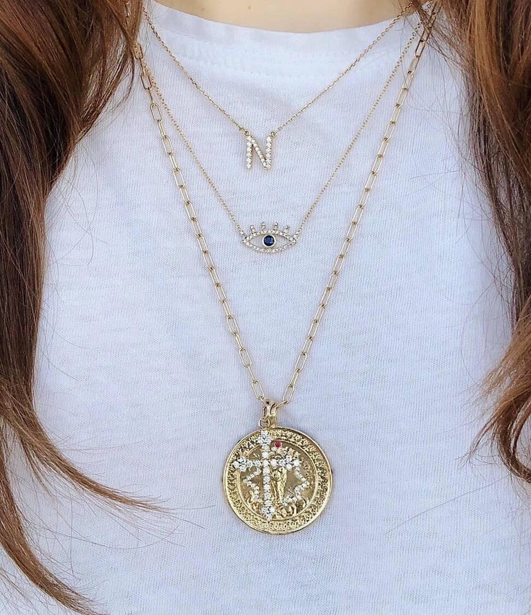 Round Cut 14 Karat Yellow Gold and White Diamond Gothic Cross Pendant For Sale