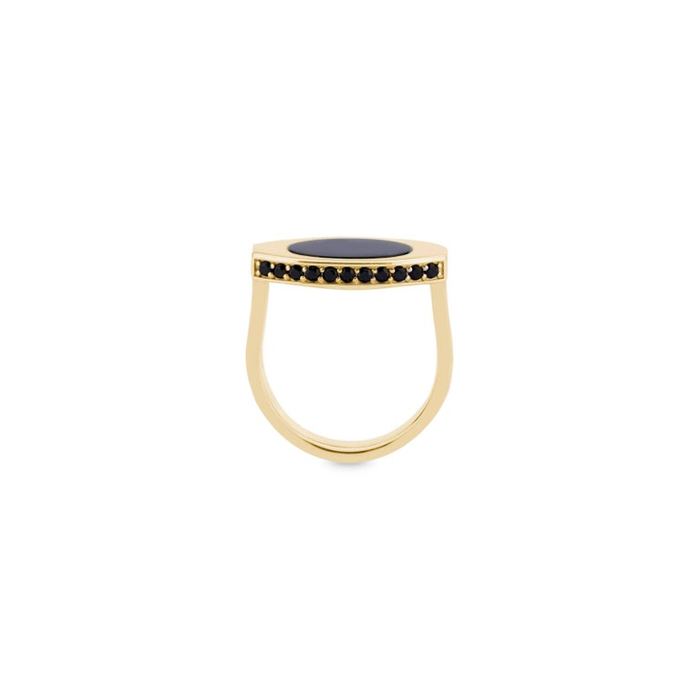 The 14k Black Onyx Signet has a chic oblong shape that complements all fingers.  It features a cabochon black onyx set into the top of the signet and 22 pavé black onyx around the edges.  This ring comes in all metals and can be made in any