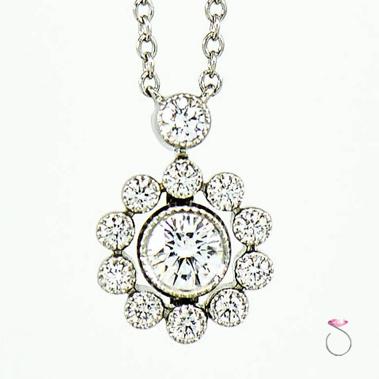 Authentic Tiffany & co. Diamond flower halo pendant with platinum chain. Gorgeous Tiffany flower halo pendant featuring one approximately 0.30 ct. round brilliant cut diamond center surrounded by ten round diamond halo & one round diamond at the top