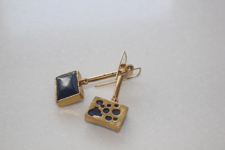 Galaxy Drop Earrings. Elegant blue lapis cabochons with speckles of gold are set in the minimalist style contemporary earrings. Brown and blue diamonds add sophistication to the design while keeping it modern.  The inspiration for these earrings