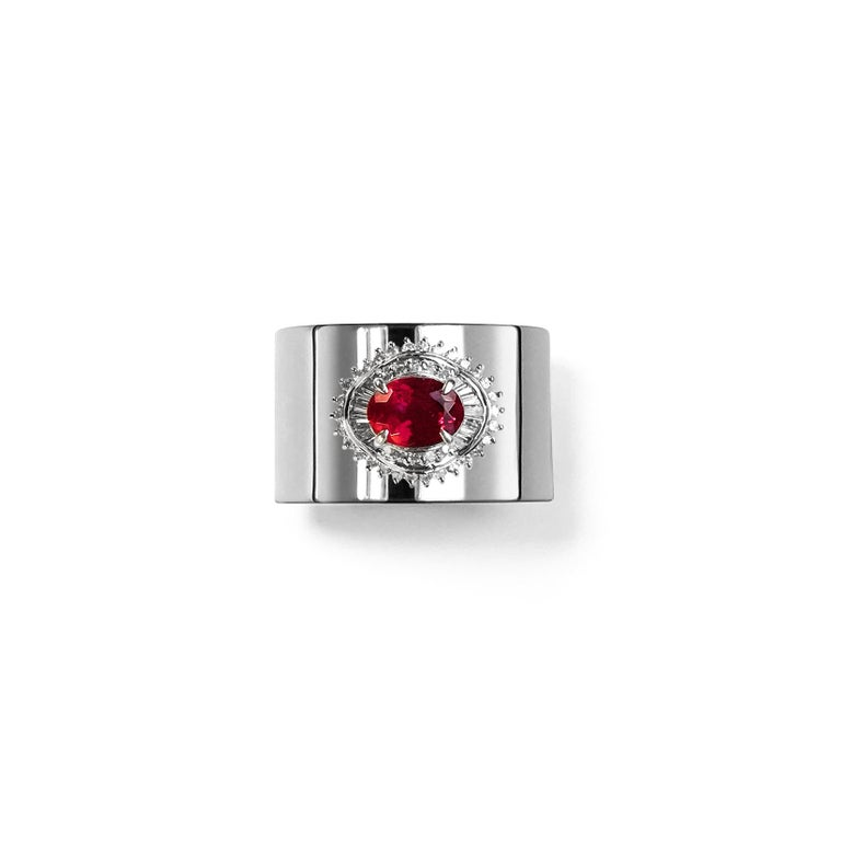 This luxurious wide-band platinum ring features deconstructed elements from repurposed vintage Tourmaline stone settings in the center. These rare and classic settings were made by highly skilled craftsmen and includes brilliant cut diamonds. This