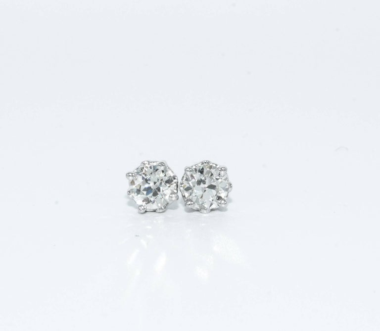 1.15 Carats Old European cut Diamond stud earrings Color is J-K , Clarity is SI1 Both Diamonds are certified by American Gem Society Laboratory ( AGS #104079007009, & 104079007010) 5.3 MM Diameter, beautifully cut and perfectly matched pair  Set in