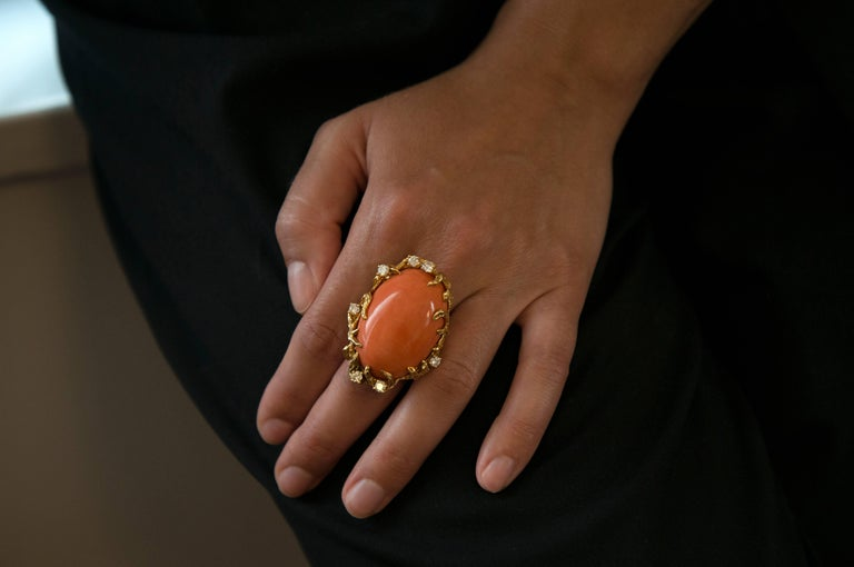A diamond and 18 karat gold ring, by Arthur King, 1970s. One-of-a-kind.  This ring is a size 7 1/2 and it is signed King and stamped 18k. The oval shape coral is 1.5