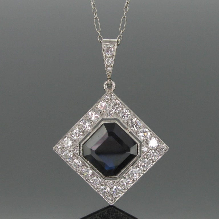 This beautiful pendant is adorned with a deep blue sapphire weighing approximately 8ct and framed with diamonds for a total of 2ct approximately (color H/I, clarity: VS). The bale and the clasp are also set with diamonds. Those are lively and