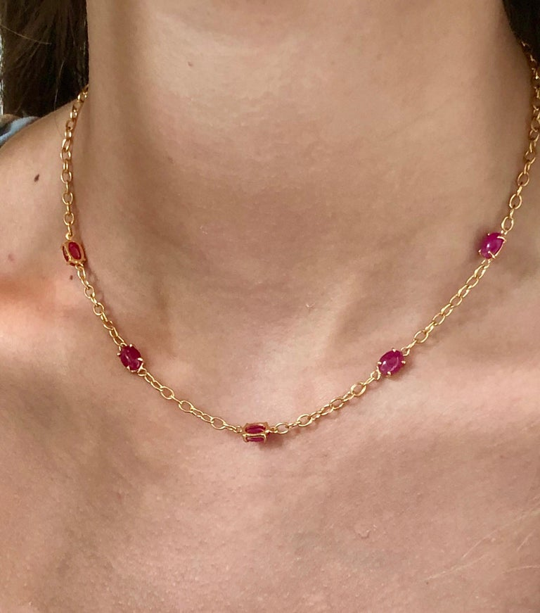 Eighteen karat yellow gold five cabochon ruby necklace pendant  One tiny diamond on lobster lock weighing 0.03 carat  Necklace measuring 16 inch long Five cabochon rubies weighing 7.80 carat Cabochon rubies are vivid red and perfectly matched Each