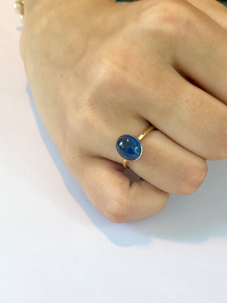 Eighteen karat white and yellow gold cocktail ring Ceylon cabochon sapphire weighing  4 carat                                                                        Ring size 6 In Stock Ring can be resized  New Ring Handmade in USA Our design team